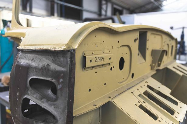 The front bulkhead of Chassis 8 being worked on in CMC's panel shop