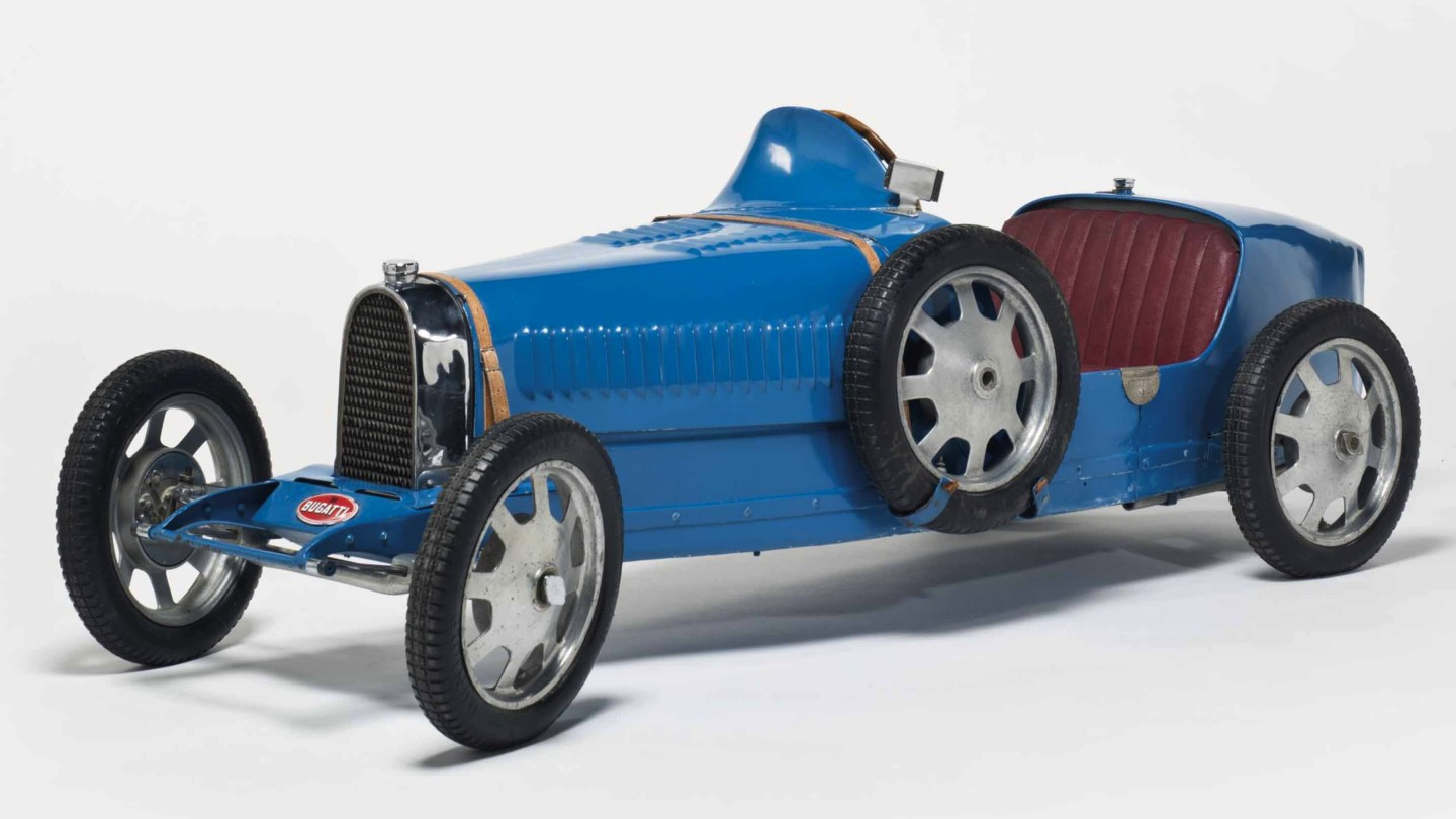 "This Bugatti Baby Type 52 electric children's car was built in 1930 and was one of four such cars purchased new by Fritz Schlumpf, one of the brothers whose automobile collection became the basis for the French National Automotive museum Cité de l'Automobile. This car was auctioned by Christie's in 2015, selling for €111,900. Two of the four cars are now in the La Cité de l'Automobile in the Collection Schlumpf in Mulhouse. The fourth ""short chassis"" Bugatti Baby from the Schlumpf collection was sold during the Estate sale of Arlette Schlumpf by Gasser Audhuy in 2009 for €65,000 (US$90,929)."
