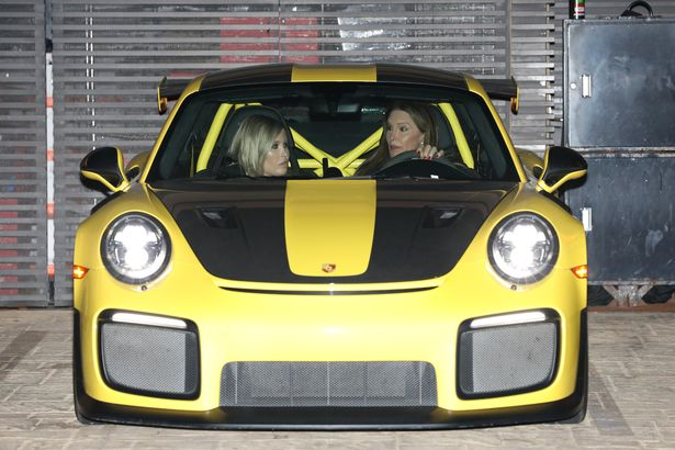 Caitlyn Jenner and Sophia Hutchins made a stylish arrival in a luminous yellow Porsche and Caitlyn was behind the wheel