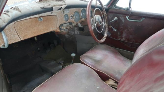 The rusted interior of the 1958 Porsche 356A Cabriolet.