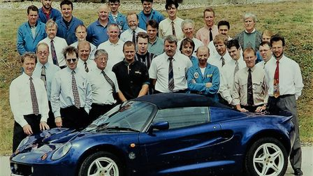 John Mountain (second right) worked for Lotus for more than 20 years, picture with employees with a Lotus Elise for which John designed the lights.