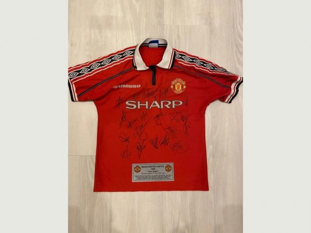 Northwich Guardian: This Roy Keane signed shirt is also included in the deal to buy the former Manchester United skipper's former car.