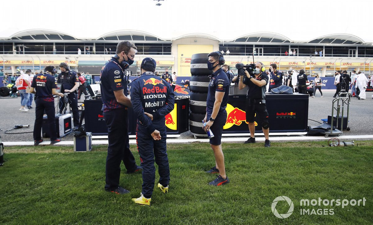 Sergio Perez, Red Bull Racing, talks to engineers on the network