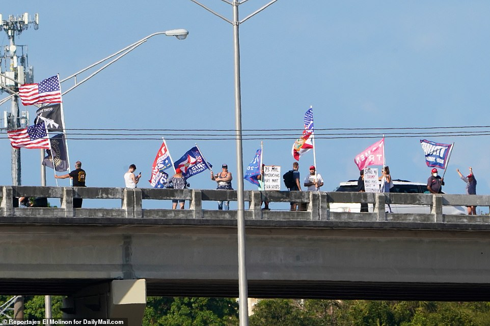 A group of Trump supporters were also pictured rallying at an overpass on I-95 in Palm Beach County, where a distracted driver later caused an automobile accident underneath
