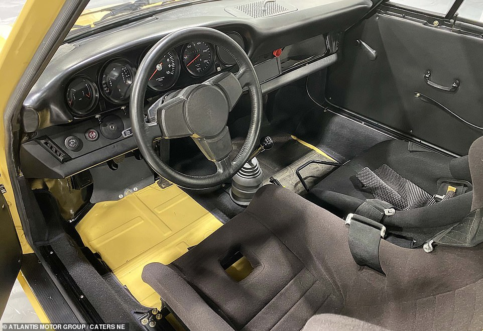 In the driving seat: A view of the interior of the Porsche, which was made in West Germany in 1974 and has now been restored after being put into storage in the years after Escobar's death in a police operation in 1993