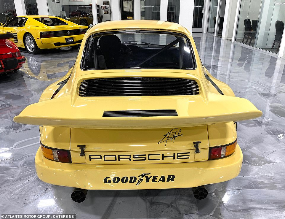 Rear view: The restored car which was once driven in the International Race of Champions and later belonged to a drug lord