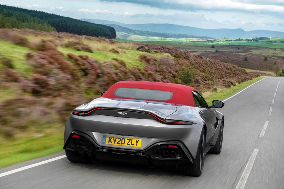 Rear three-quarter view of Aston Martin Vantage Roadster with the roof up