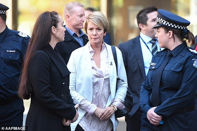 Mother of Josh Prestney, Belinda Prestney (centre) is seen outside the County Court of Victoria in Melbourne dor Pusey's sentencing