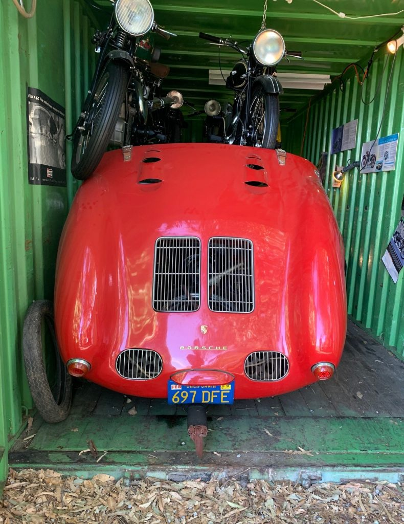 Old Crow - 1955 Porsche 550 Spyder - rear in container with bikes overhead