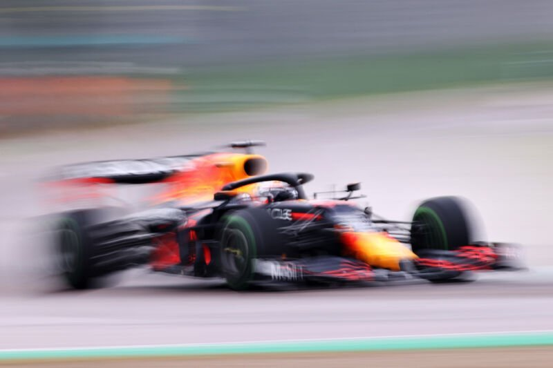 A blurry photo of a Red Bull Racing F1 car at speed