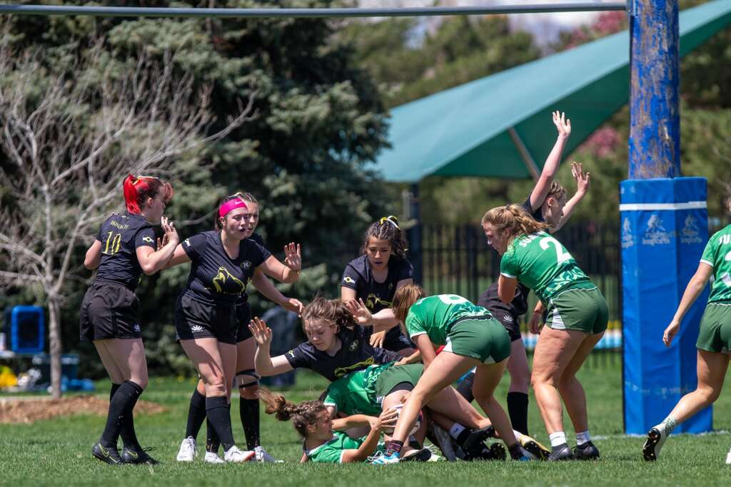 Bryton Ferrari, botto, scrambles for the ball during play against Monarch at the high school rugby state championship on Saturday, May 1, 2021, at Cook Park in Denver. The Summit High girls rugby team won their 13th-straight state championship title. | Photo by Liz Copan / Studio Copan