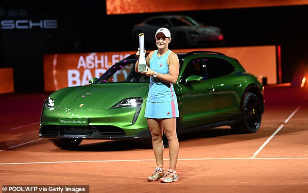 Ash Barty (pictured on April 25) won a $200,000 Porsche as well as the $107,000 prize money at the Porsche Tennis Grand Prix