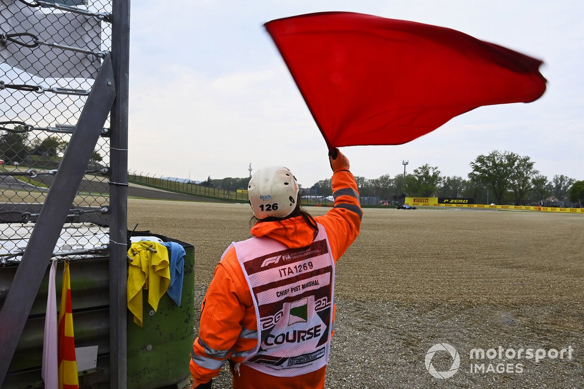 A marshal waves the red flag