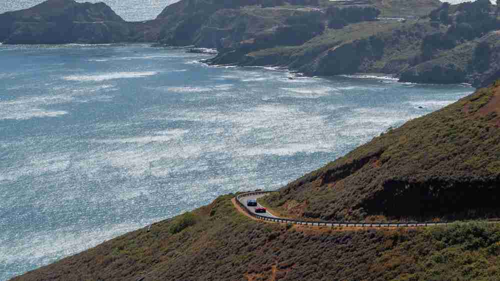 Participants in Robb Report's California Coastal road rally skirt the Pacific Ocean while tracing through Northern California.