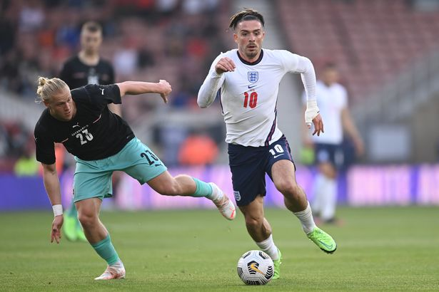 Jack Grealish of England runs with the ball whilst under pressure from Xaver Schlager of Austria during the international friendly match between England and Austria at Riverside Stadium on June 02, 2021