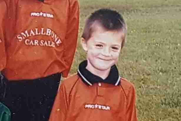 Age 6, Jack Grealish proudly poses in his under-7s strip with sponsor