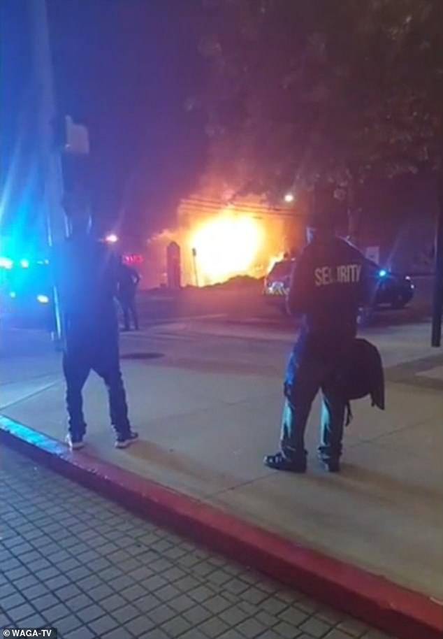 The fire was started after a Porsche Cayenne drove into the strip mall while eluding cops