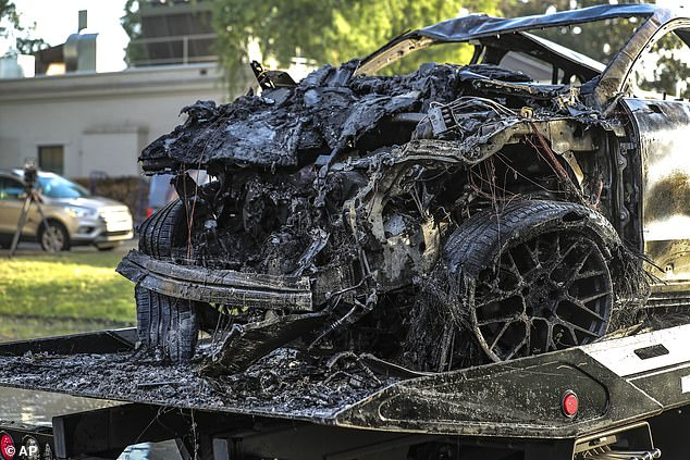 The charred remains of the Porsche Cayenne were all that were left after the crash