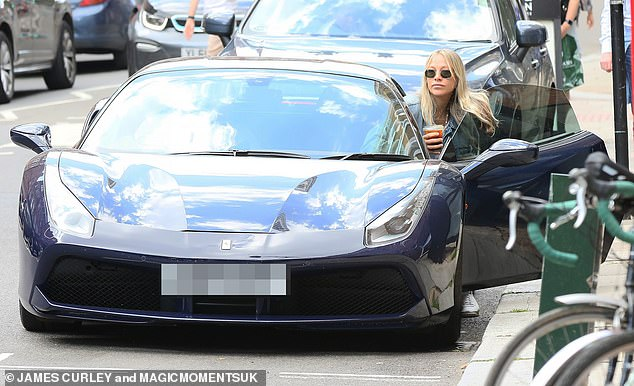 Nice wheels:Meanwhile James looked casual in a white T-shirt and cream chinos as they pair hopped into their Ferrari to head home after their trip out
