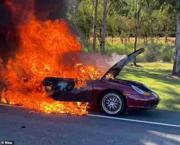 A Porsche driver on the Gold Coast is lucky to be alive after their luxury sports car burst into flames (pictured) on Monday