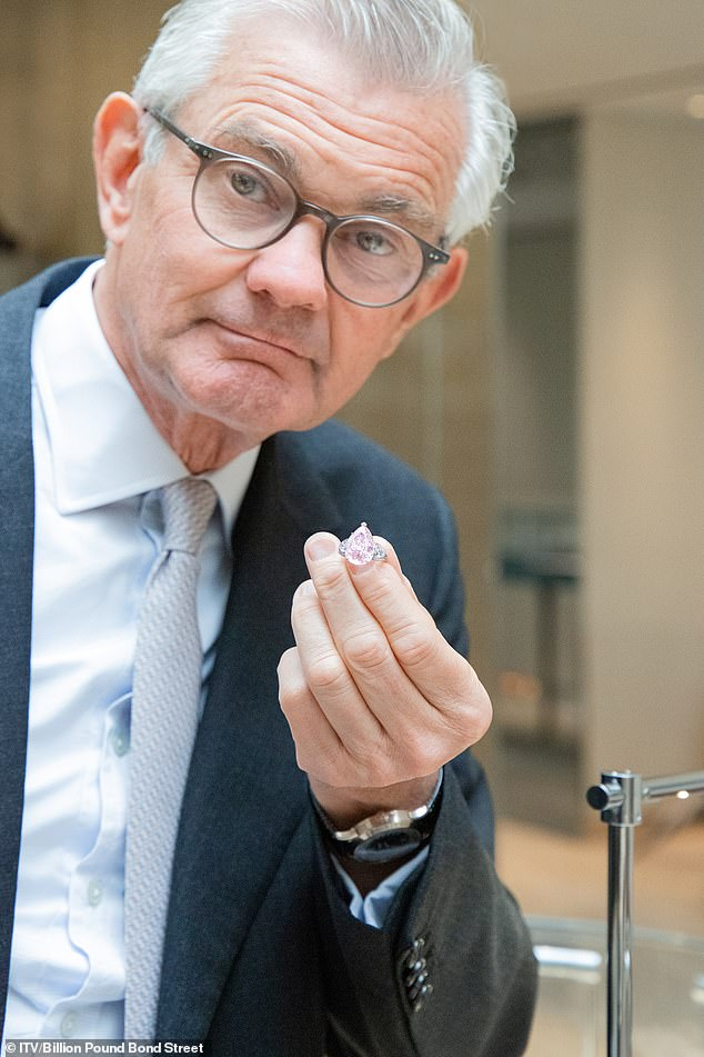 Michael Wainwright of British Jewellers Boodles hold a pink diamond valued at 3.2 million pounds (pictured)