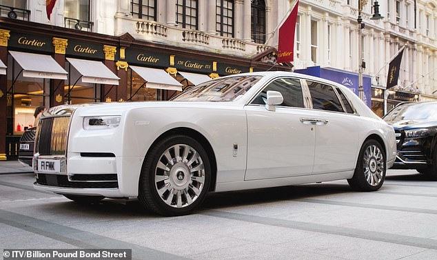 The glamorous half mile between Oxford Street and Piccadilly boasts more luxury brands and more royal warrants than any other in Britain. Pictured, Rolls Royce parked in New Bond Street