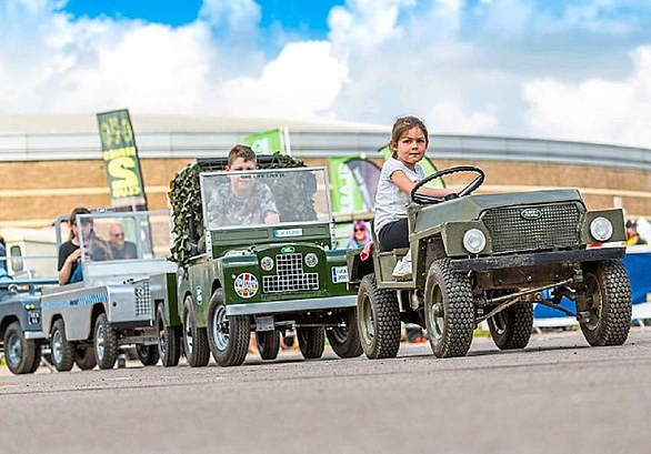 Driving ambition: Youngsters at a Land Rover show.Coventry MotoFest runs through July and August