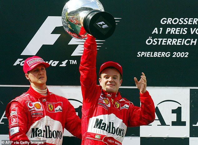 Rubens Barrichello (right) and Michael Schumacher (left) were booed by fans after team orders saw Barrichello let his team-mate past for victory on the final corner in Austria in 2002