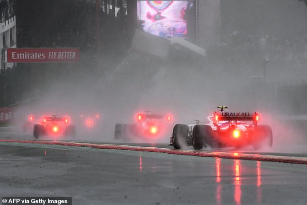Torrential rain saw the Belgian Grand Prix reduced to the shortest race in the sport's history