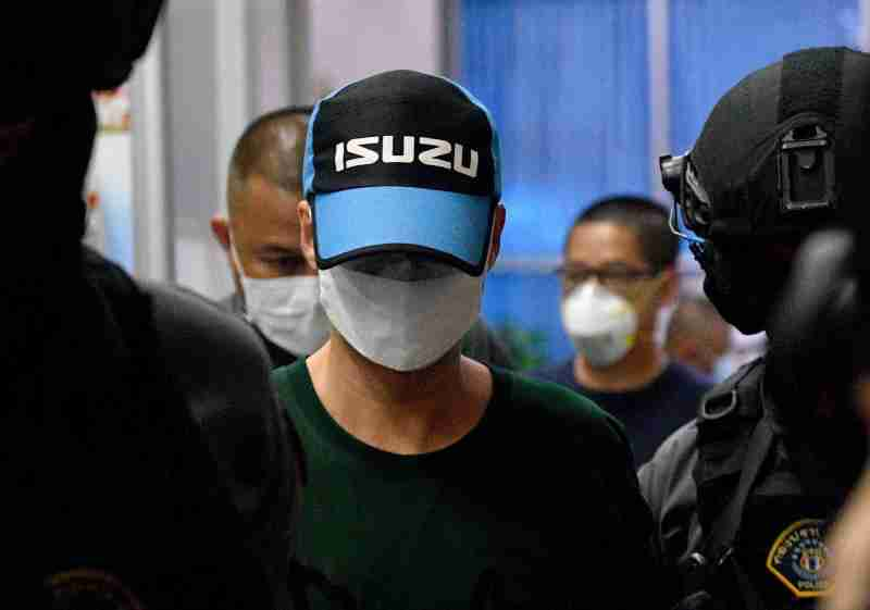 Pol Col Thitisan Utthanaphon, the prime suspect in the case involving the alleged fatal torture of a drug suspect in Nakhon Sawan is taken to the Crime Suppression Division on Thursday. (Reuters photo)