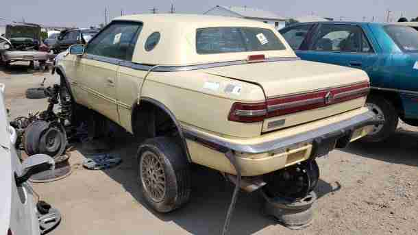 1991 Chrysler TC by Maserati in Colorado junkyard, LH rear view - ©2021 Murilee Martin - The Truth About Cars