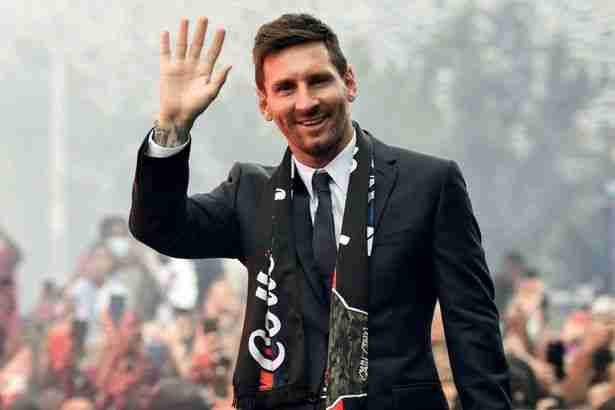Paris Saint-Germain's Argentinian forward Lionel Messi salutes supporters gathered outside the Parc des Princes stadium after his first official press conference as PSG player in Paris on August 11, 2021.