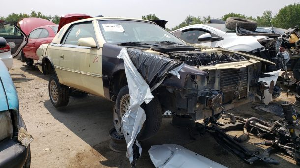 1991 Chrysler TC by Maserati in Colorado junkyard, RH front view - ©2021 Murilee Martin - The Truth About Cars