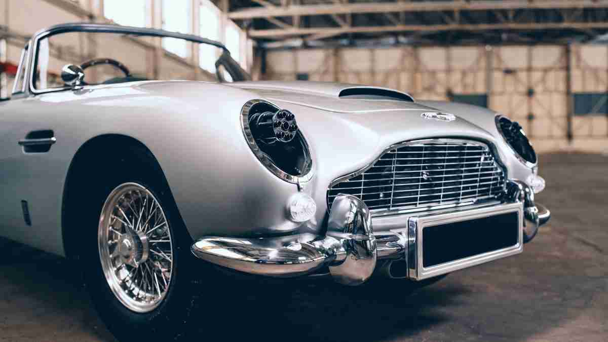 'No Time to Die' James Bond Special Edition Aston Martin DB5 promotional image with toy miniguns behind the headlamps