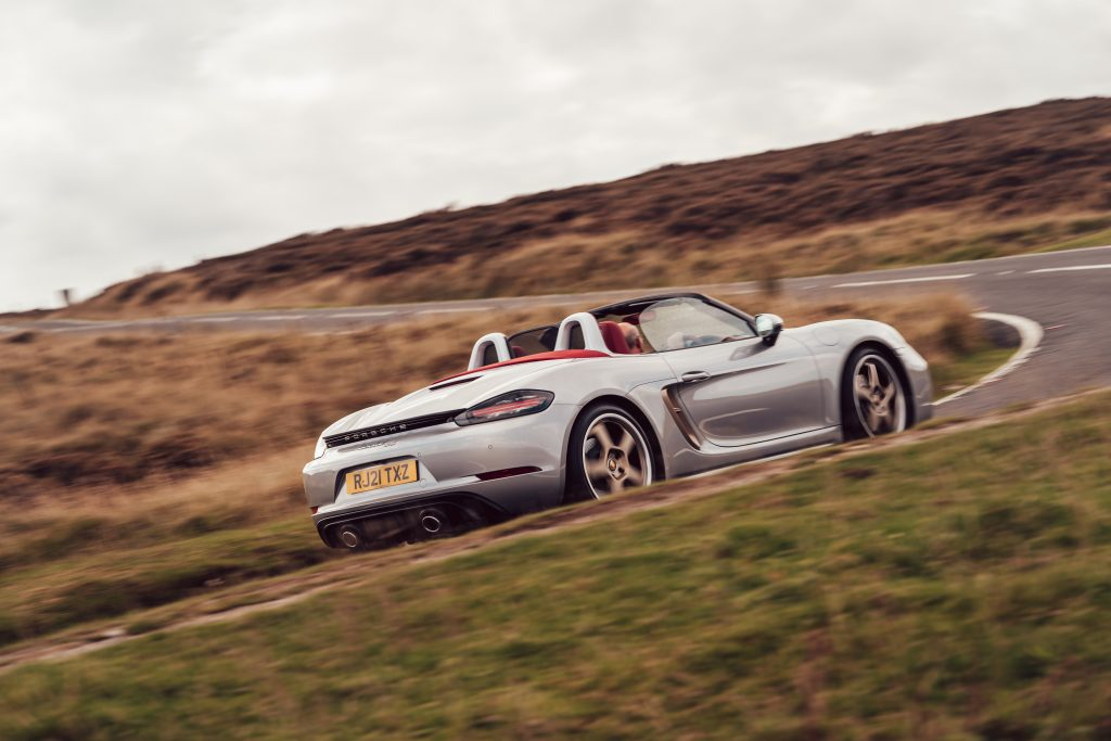 2021 Porsche Boxster 25 Years rear three-quarter driving action